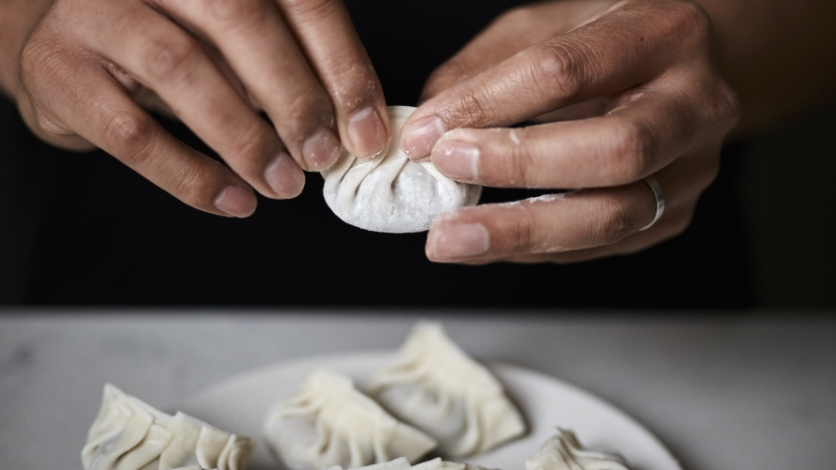 Chef Thomas Chen from Tuome makes dumplings at his home in Flushing.