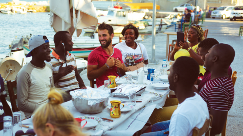 Immigrants dining together in Lesbos, Greece.