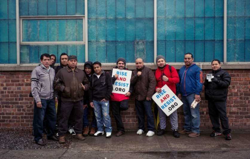 Tom Cat Bakery workers stand against ICE crackdown.