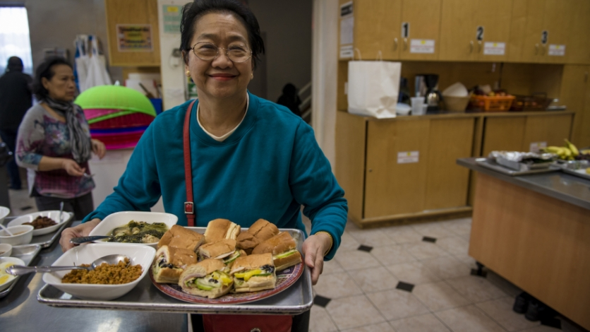 Jeannie Ongkeo cooks for the monks and worshippers at the Wat Buddha Thai Thavorn Vanaram temple in Elmhurst.