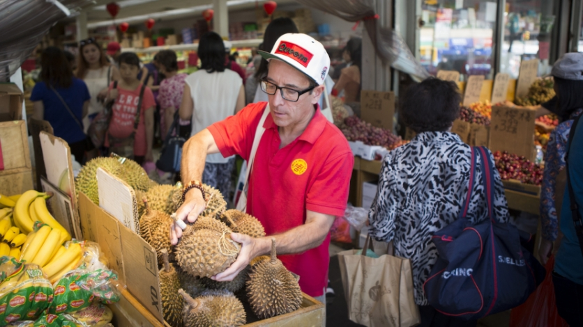 Joe DiStefano picking up a durian at Queens market.