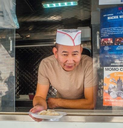 Amdo Kitchen owner Thumden Amchok with momos.