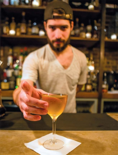 Cody Calderon with an Apothecary in an etched cocktail glass.