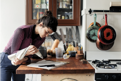 Lexie Smith in her Ridgewood home, piping out squiggly charcoal-activated pâte à choux doughs.