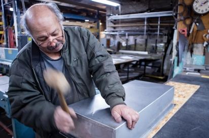 Sheetmetal worker Nestor Lugo of 800BuyCart builds a stainless steel bain-marie for a food cart.