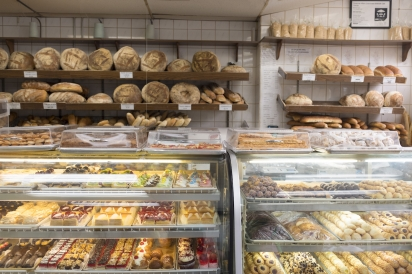 Tempting pastries and bread at Gian Piero Bakery in Long Island City Queens New York.