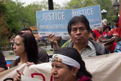 Tom Cat Bakery workers and other supporters stand against ICE crackdown.