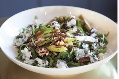 The Queen's Room's Pear Salad arugula, blue cheese, roasted pecans, balsamic reduction