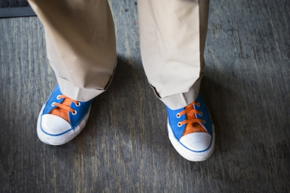 Joe DiStefano with his blue and orange Converse exploring the Queens culinary scene.
