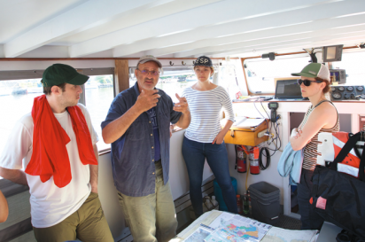Riverkeeper's Captain John Lipscomb takes a group of guests from the environmentally-conscious clothing manufacturer, Patagonia, on a tour of Newtown Creek.