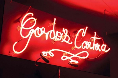 Gordo's neon sign gives a red glow.