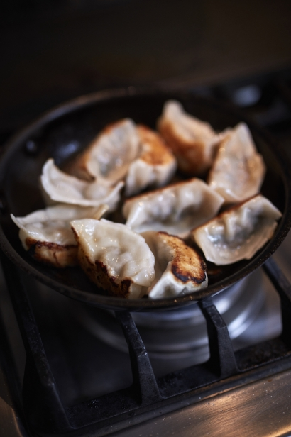 Dumplings getting fried at Chef Thomas Chen's house in Flushing.