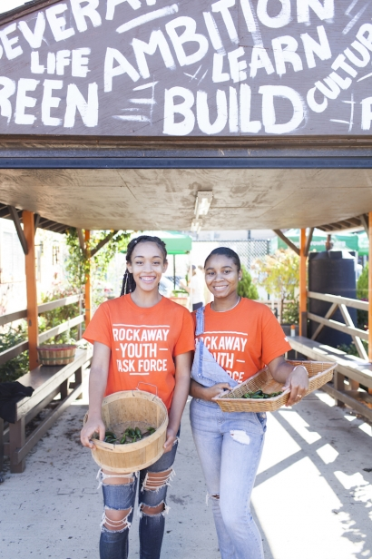 Cerissa Higgins (L), youth leader, and Tamera Jacobs (R), director of operations, with peppers at Rockaway Youth Task Force, Far Rockaway.