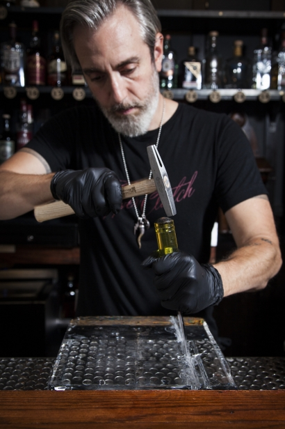 """Richard """"Richie"""" Boccato of Dutch Kills Bar and Hundredweight Ice chiseling ice for a cocktail."""