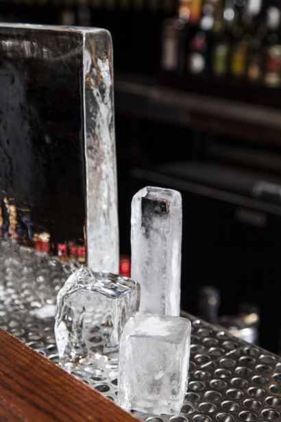Ice carved to fit glasses of different shapes, to maximize cooling while minimizing surface area, melting and dilution.