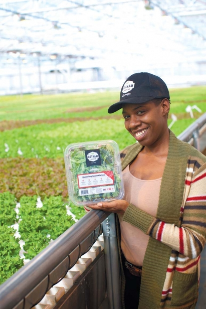 customer service rep Victoria Wheeler with a package of their Queens Crisp Gourmet Lettuce