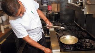 Sonny Solomon of Kurry Qulture making jalebis at his restaurant in Astoria.
